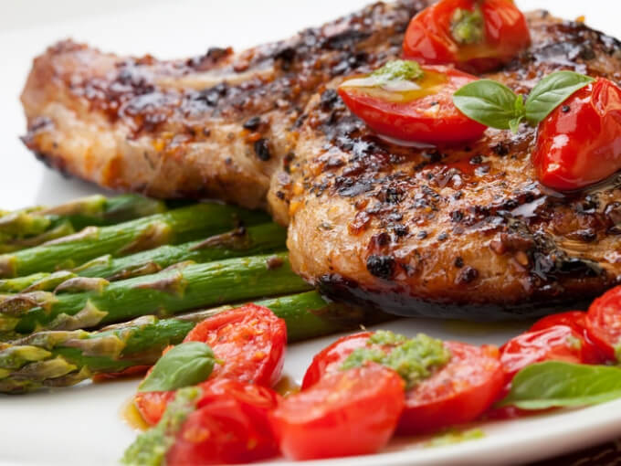 Keto Grilled Pork Chops With Asparagus And Pesto